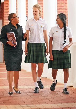 US Consul General Cynthia Griffin with head girls at St Brigids, Claudia Sallas and Daffodil Joseph-Anton.