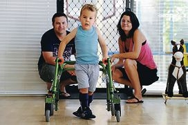 Walking chance: Archer Johnson (4) with his parents Kyle and Lisa. Picture: Marcus Whisson www.communitypix.com.au d416059