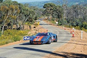 A classic car winds its way around the country roads near Toodyay.