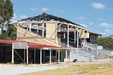The damaged grandstand which will be repaired.