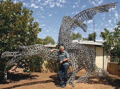 Otto Hampel, of Northam, with his latest dragon sculpture creation.