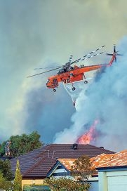 A helicopter reloads with water; Picture by Darren Speedie from Vision Inspired Photography.