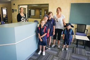Amy O'Reilly with (from left) daughters Sophie (8), Holly (9), Katelyn (11) and son Alfie (4) arrive for their first day at John Butler Primary College.