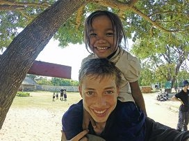 Willetton resident Jesse Tucek with a student from the Mkak village in Cambodia, where his volunteer group built a new classroom.