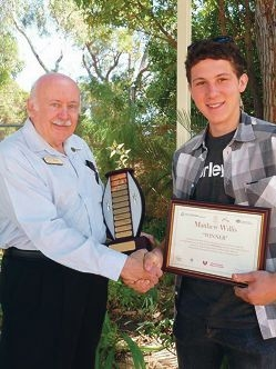 Event Assist chairman Terry Cockerham with award winner Matthew Willis.