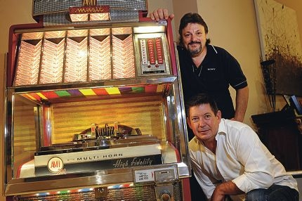 Jukebox restorer Vic Donis with business partner Rick