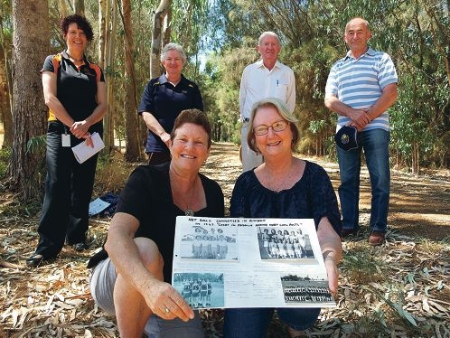 Fourth generation Bindoon sisters Dawn Kay and Marilyn Morrice with some old netball photos, as Karen Dore, Helen Manning, Boyd Martin and Robert Hawes look on.