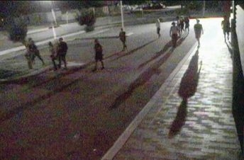 Groups of youths roam Midland's streets at night.