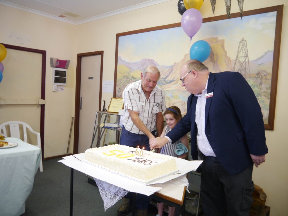 Shire President Andrew Waddell, (right), Anna-Lee and Eric Morey cut the 50th anniversary cake.