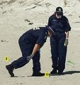 Police on the beach at the site of the brawl. Pictures: Kym Ilman