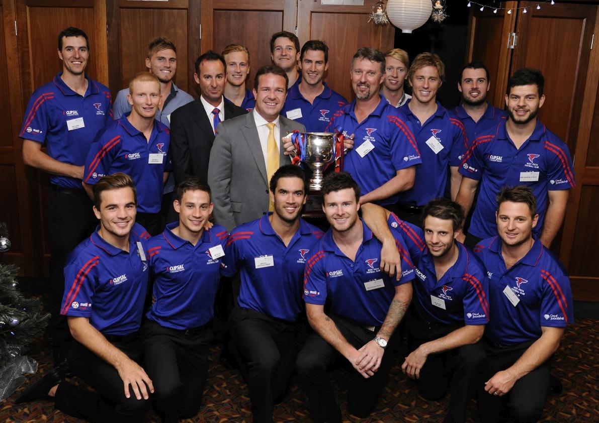 The West Perth premiership winning team with club president Brett Raponi, Joondalup Mayor Troy Pickard and coach Bill Monaghan.