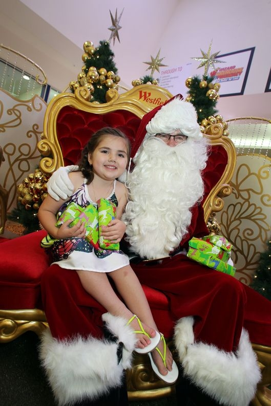 Natalina Barbosa (5) of Wattle Grove with Santa at the Westfield Carousel Shopping Centre in Cannington.