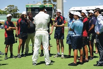 Fast bowler Mitchell Johnson talks to Clontarf Foundation students