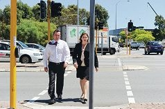 Opposition leader Mark McGowan and West Swan MLA Rita Saffioti cross Reid Highway on Malaga Drive. d412397