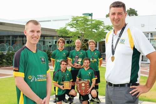 Curtin University soccer player Daniel Tibbett and club president and coach Campbell Ballantyne with players Carlo Chiellini, Luke Monks, Bryce Young, Antony Russo and Kye Middleton.