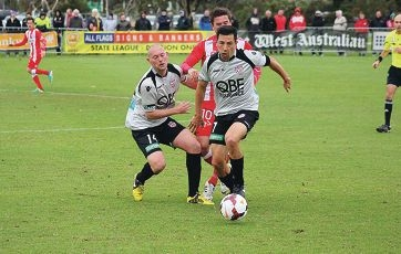 Perth Glory skipper Jacob Burns and teammate Steve McGarry in action against Melbourne Heart's Harry Kewell at Peelwood Reserve in September. Perth Glory and Mandurah City Football Club will hold a soccer school clinic.