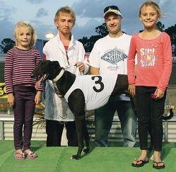 Stanga Tom with handler Ben Yates, owner Jason Marley and his two daughters.