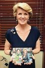 Julie Bishop holds a picture of herself and Aung San Suu Kyi.
