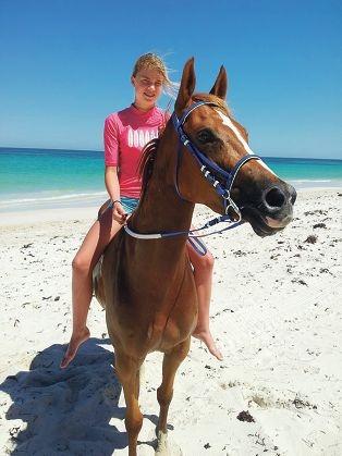 Tegan rides Lulu at the beach.