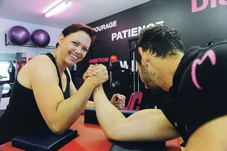 Australian women's arm wrestling champion Lisa Kulasalu with her personal trainer Seth Maserow. Picture: Marcus Whisson www.communitypix.com.au d412062