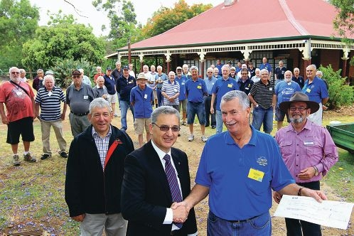 Amaroo board of directors president Norm Smith, Southern Districts Rotary president John Rechichi, Gosnells Community Men's Shed chairman Geoff Wiltshire and Gosnells Mayor Dave Griffith, with Men's Shed members.