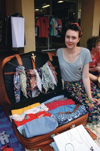 Emily Ziegelaar and her suitcase stall full of vintage clothing .