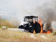 Tractor blaze flares while