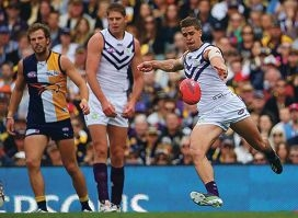 PERTH, AUSTRALIA - JULY 14: Stephen Hill of the Dockers kicks the ball forward during the round 16 AFL match between the West Coast Eagles and the Fremantle Dockers at Patersons Stadium on July 14, 2013 in Perth, Australia.  (Photo by Paul Kane/Getty Images)
