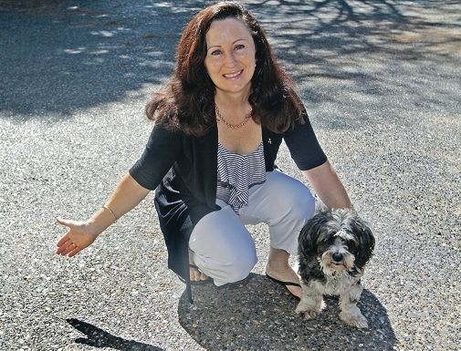 Michelle Hodges and her dog Buffy on the new concrete driveway.