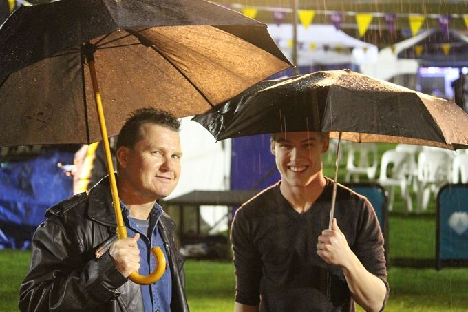 Keith and Jake Kendrick in the rain at Relay for Life at Arena Joondalup on Saturday night . Picture: Justin Bianchini
