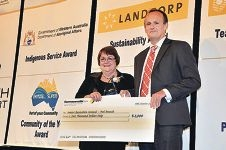 Peel branch's Jan McGlinn accepts the award from Prime Super chief executive Lachlan Bird.