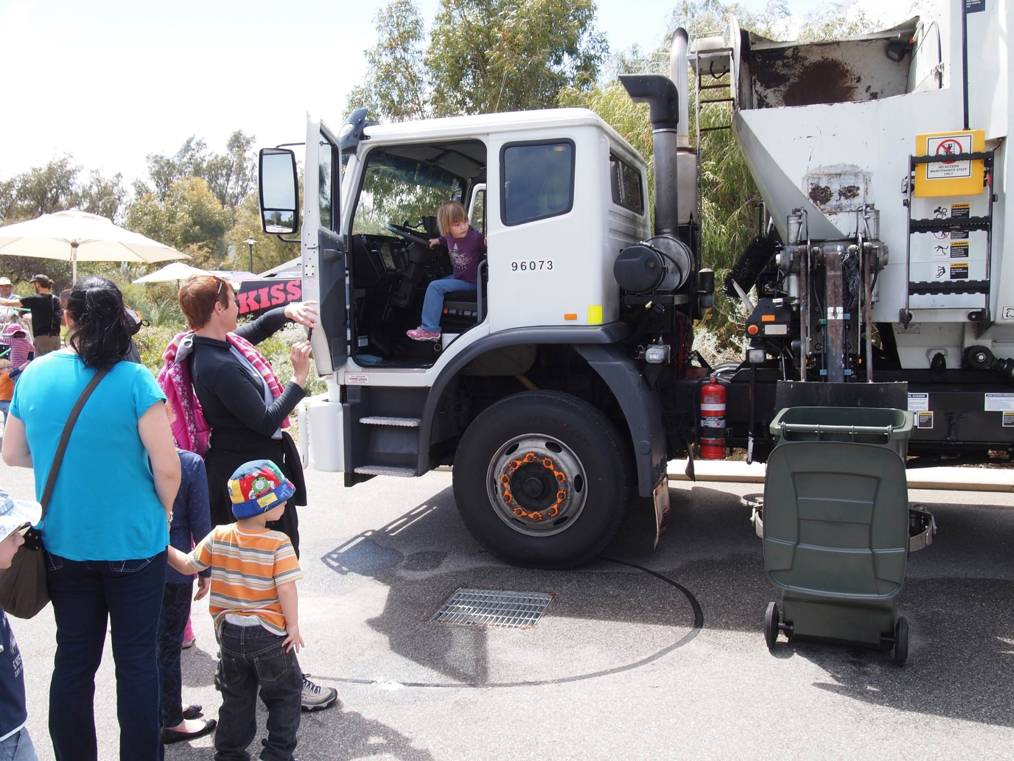 Visitors took the driver's seat in a City of Wanneroo rubbish truck (top) and Junkadelic Collective perform.
