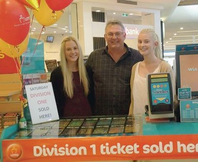 Midland Gate Lottery Kiosk owner Lance McCrae with daughters Amy and Ellie.