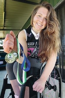 Georgia Inglis with her Women's National Wheelchair Basketball League Championship gold medal. Picture: Bruce Hunt d408923