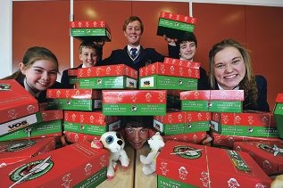 Erin Milroy, James Boucaut, Nic Sparrow, Kieran Turner and Jacinta Dansey with Lauchy Dance (middle) and some donations. Picture: Jon Hewson d408086