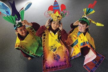 Burrendah Primary School students Reece Anapu, Helen Ye and Chad Warner in their colourful wearable art. Picture: Marcelo Palacios www.communitypix.com.au d408514