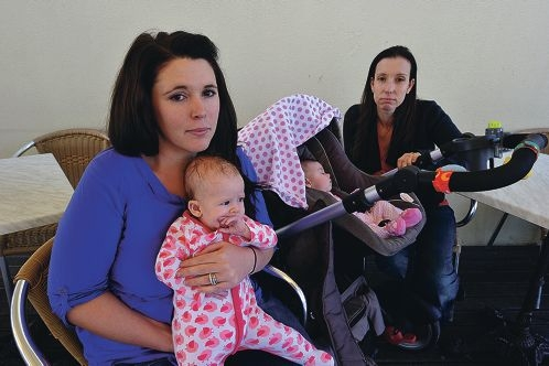 Jessica Dawson with her baby Summer and Sarah Lehmann with her baby Lucy. Picture: Jon Hewson d408270