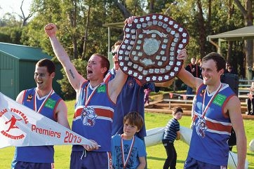 Gidgegannup captain Cam Hoe (right), and vice captains Jamie McMahon and Gavin Scott, celebrate the 2013 premiership win.