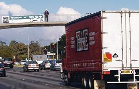 Mike Nahan on the pedestrian bridge over Leach Highway, Rossmoyne in 2008, campaigning to finish Roe Highway.