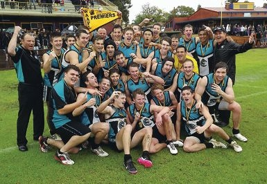The Canning Vale Cougars colts team celebrate their win in the WAAFL grand final on Saturday.