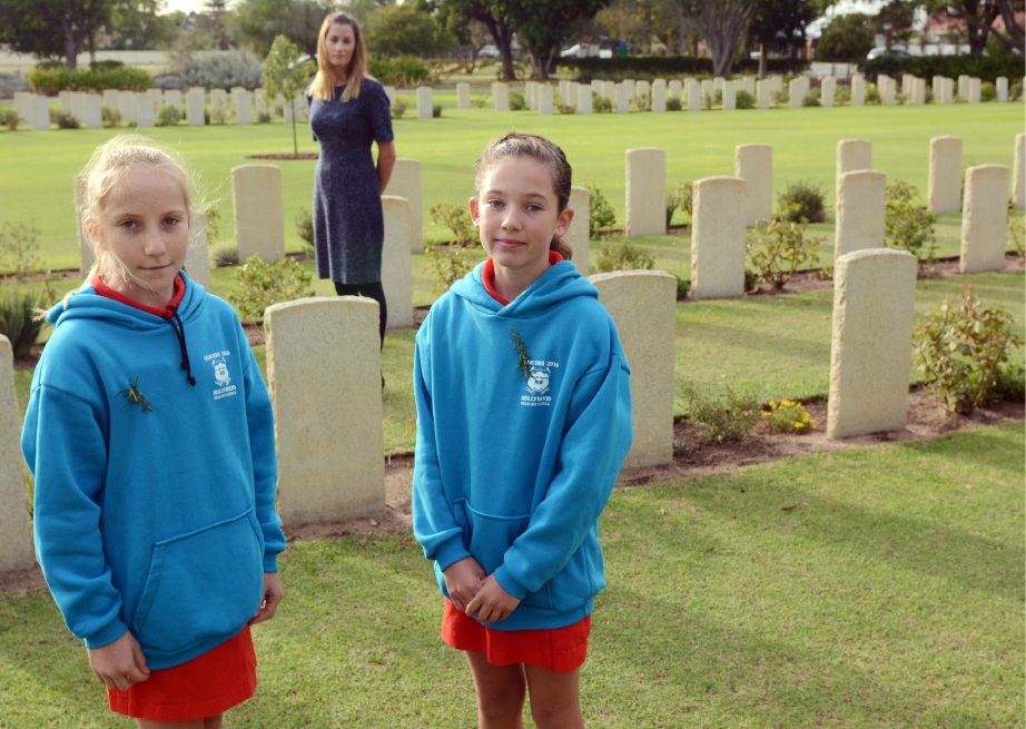 Hollywood Primary School associate principal Fiona McBeath with students Amelie Sampson and Clair Bolton at the war graves cemetery. Picture: Jon Bassett.