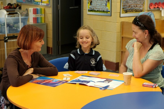 Scitech representative Helen Oke with Lily and Juliette Lamb at Carcoola Primary School.