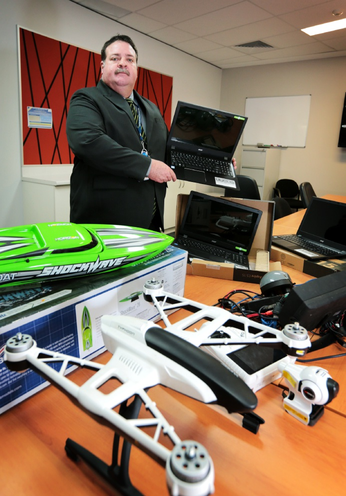 Det Sgt Gary Butler with some of the $150,000 worth of stolen property seized in recent raids. Picture: David Baylis d454083