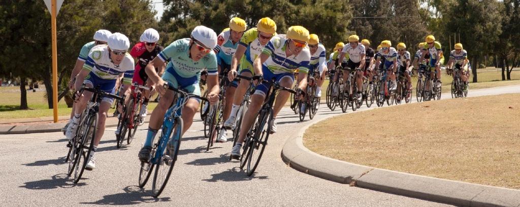 Five A grade breakaway riders (white caps) pass B grade. Picture: Richard Williamson
