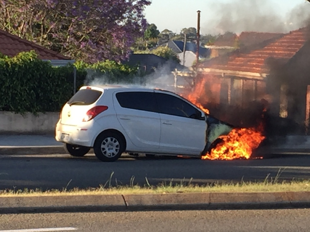 The car burned for about half an hour before fire fighters arrived. Picture: David Johns