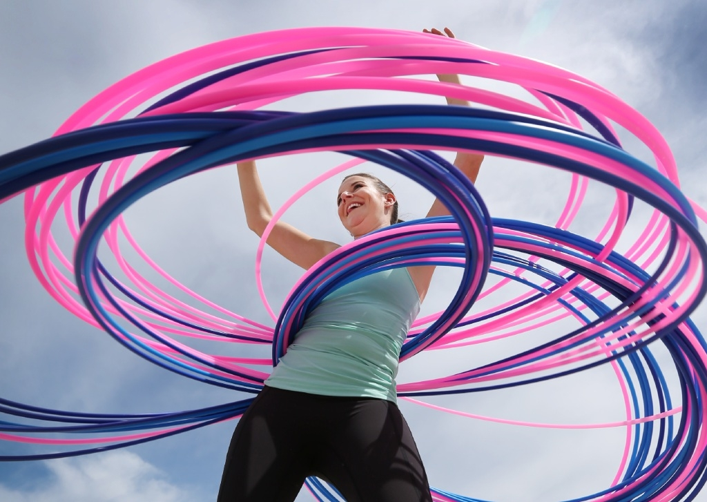 Hoop-la: Bree Kirk-Burnnand is attempting to break the Guinness world record for number of hoops spun simultaneously.  Picture: Andrew Ritchie www.communitypix.com.au   d446074