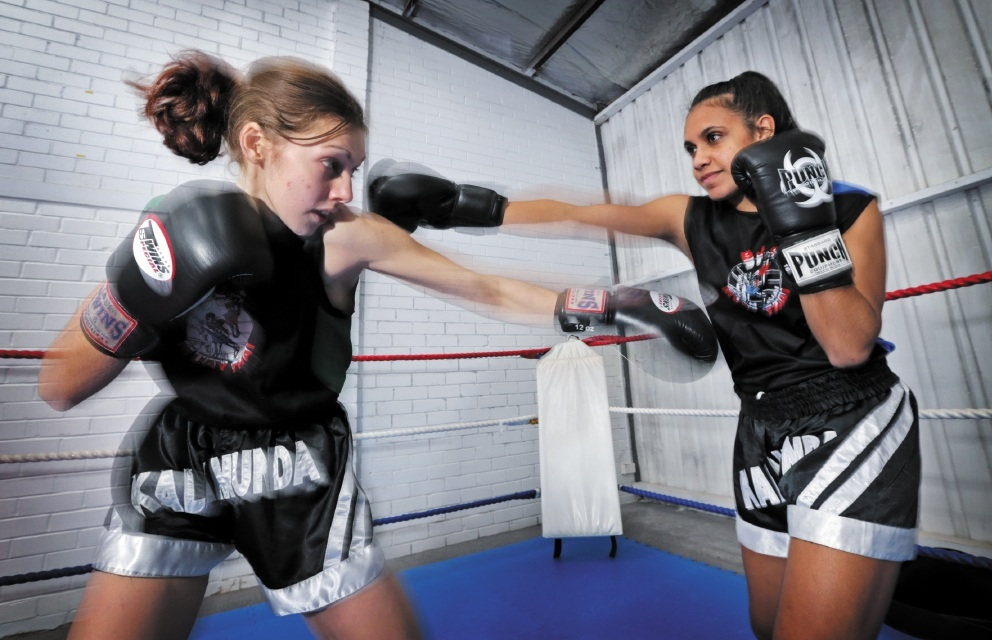 Laura Bell and Kaelee Hamlett spar in the ring before a training session begins. Picture: David Baylis        www.communitypix.com.au   d442655