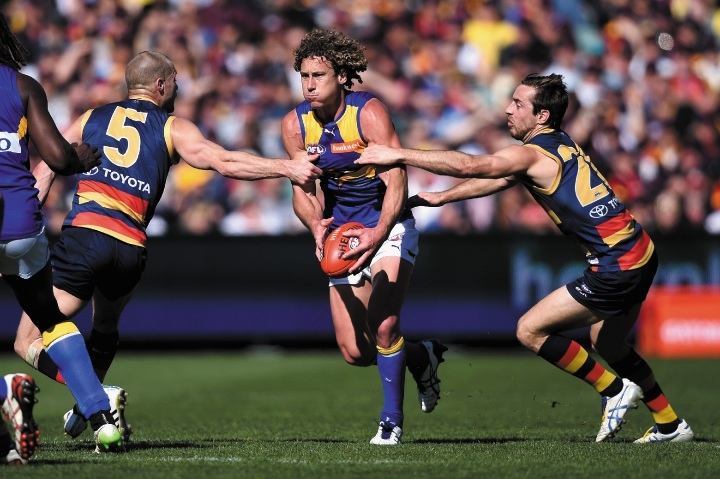 Eagles midfielder Matt Priddis tries to evade Adelaide's Scott Thompson and Richard Douglas during the match Adelaide Oval on Sunday. Photograph: Daniel Kalisz/Getty Images.