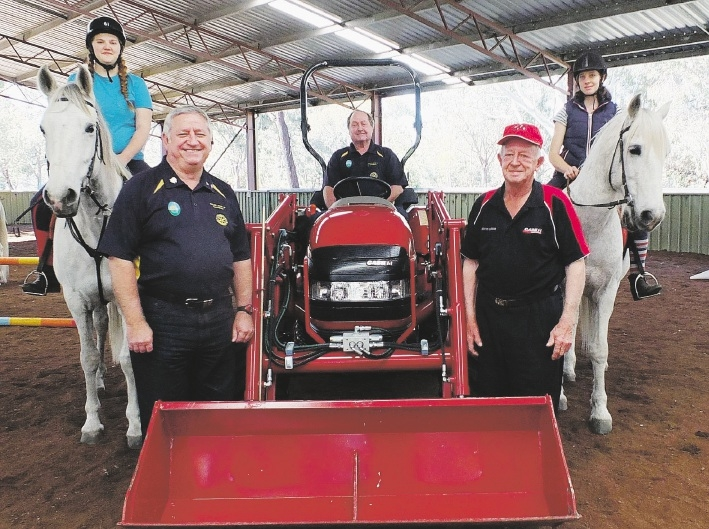 Riders Brooke Reilly on Duchess and Abbi Robertson on Alex with Rotarians  (left)Ray Perkins, Peter Miskelly (seated) and Laurie Duffy with the new tractor.