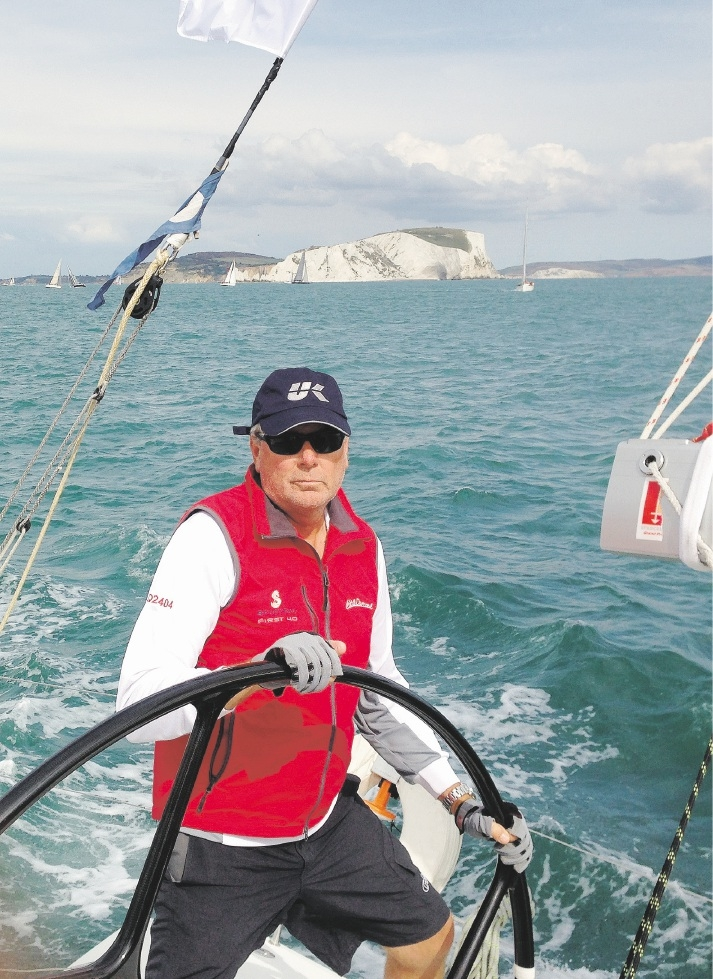 Neil Harrison steers out of the Solent with the famous chalk cliffs coastline in the background.